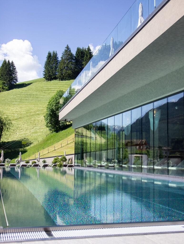 das_edelweiss_salzburg_mountain_resort_pool_view_1